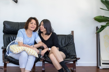 Puiyee with her mother, who, despite her fear of pain, has once considered to let Puiyee ink her upper arm.